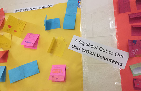 Photograph of elementary school wall that shows thank you notes from students along with a shout out to WOW volunteers.
