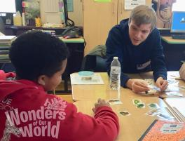 Photo of WOW volunteer working with 5th grader on the all about fruits and vegetables activity
