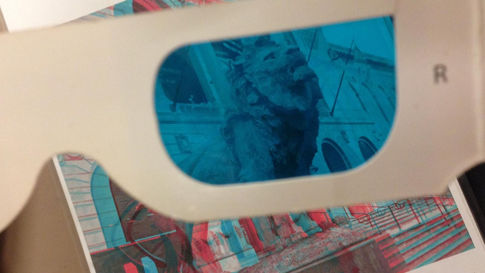 Photograph of 3D glasses and the image of a lion statue popping out